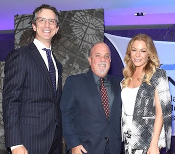 NMPA President/CEO presents Billy Joel with the organization's Songwriter Icon Award at the group's Annual meeting in New York, June 2015. LeAnn Rimes (R) performed several of Joel's songs.